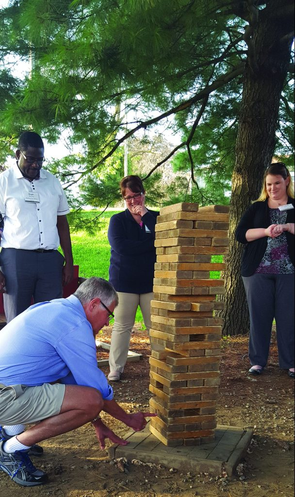 Country Meadows employees playing a giant game of Jenga